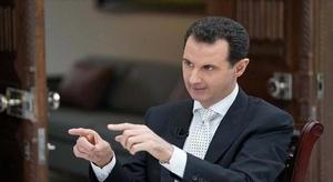 بشار الأسد يحمل ست د